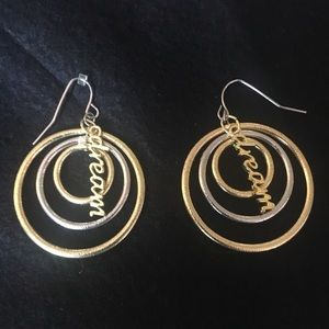 "Gold & silver circular design w/ the word ""Dream"""